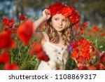 beautiful girl in poppy wreath... | Shutterstock . vector #1108869317