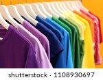 rainbow clothes on hangers... | Shutterstock . vector #1108930697