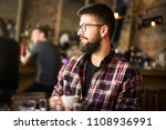 bearded hipster man in a coffee ... | Shutterstock . vector #1108936991