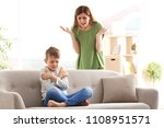 mother arguing with son at home | Shutterstock . vector #1108951571