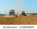 two tractors drilling in a... | Shutterstock . vector #1108968809