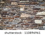 background texture of a stone wall - stock photo
