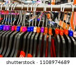 Small photo of Different sized hanger with colourful dress size tags XL L M XS t shirts displayed in shop for sale
