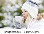 Girl Drinking Hot Tea In The...