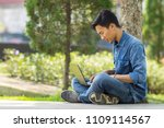 asian young  man using computer ... | Shutterstock . vector #1109114567