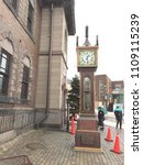 Small photo of Hokkaido, JAPAN - Feb 14, 2015: Antique steam clock is steaming at 01.30 P.M. in front of the Music Box Museum on Sakaimachi-dori street, Otaru. The clock runs on steam and chimes every 15 minutes.