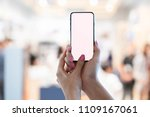 woman hand holding mobile phone.... | Shutterstock . vector #1109167061