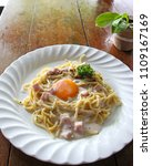 spaghetti carbonara with egg... | Shutterstock . vector #1109167169