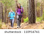 Hikers In Forest. Couple Hikin...
