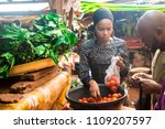 a girl selling tomatoes to a... | Shutterstock . vector #1109207597