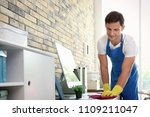 young man in apron and gloves... | Shutterstock . vector #1109211047