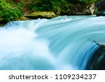 River Flowing In The Forest In...
