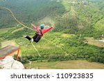jump off a cliff with a rope. | Shutterstock . vector #110923835