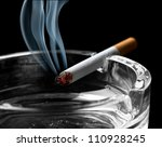 Closeup Of Cigarette On Ashtra...
