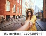 pov of a young woman holding a... | Shutterstock . vector #1109289944