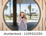 retro solo traveller girl using ... | Shutterstock . vector #1109321354
