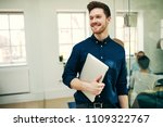 smiling young businessman... | Shutterstock . vector #1109322767