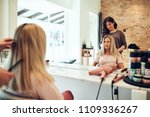 young blonde woman sitting in a ... | Shutterstock . vector #1109336267