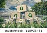 cardboard boxes with recycle symbol in a beautiful meadow - stock photo
