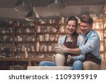 smiling couple behind a potter... | Shutterstock . vector #1109395919