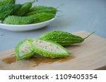 cut of bitter melon or bitter... | Shutterstock . vector #1109405354