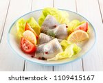 Stock photo marinated herring with vegetables 1109415167