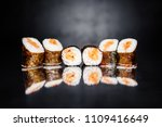 sushi roll with salmon on black ... | Shutterstock . vector #1109416649