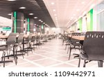 Stock photo modern interior of cafeteria or canteen with chairs and tables eating room in selective focus 1109442971