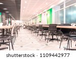 Stock photo modern interior of cafeteria or canteen with chairs and tables eating room in selective focus 1109442977