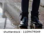 a child walks through puddles ... | Shutterstock . vector #1109479049