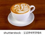 hot cappuccino cup with cream | Shutterstock . vector #1109495984