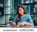 asian woman drinking coffee in  ... | Shutterstock . vector #1109527691