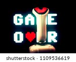 Small photo of A retro vintage joystick (input device for computer games) in front of a cute 8-bit Game Over screen (with a heart replacing a letter).