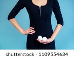 eggs in the hands of a sexy... | Shutterstock . vector #1109554634