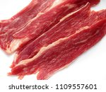 raw beef bacon isolated on... | Shutterstock . vector #1109557601