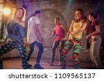 group of young modern dancers... | Shutterstock . vector #1109565137