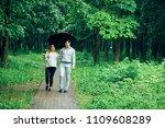 attractive couple under an...   Shutterstock . vector #1109608289