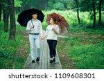 attractive couple under an...   Shutterstock . vector #1109608301