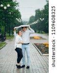 attractive couple in the rain...   Shutterstock . vector #1109608325
