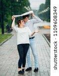 attractive couple in the rain...   Shutterstock . vector #1109608349