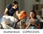 angry girl scolding her messy... | Shutterstock . vector #1109613101