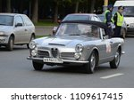 Small photo of MOSCOW, RUSSIA - SEPTEMBER 24, 2011: Old timer cars rally start - classic Italian Alfa Romeo 2600 Spider Carrozzeria Touring car.