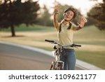 cheerful girl cyclist gesturing ... | Shutterstock . vector #1109621177