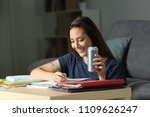 happy woman studying late hours ... | Shutterstock . vector #1109626247