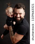 handsome tattooed adult father... | Shutterstock . vector #1109663321