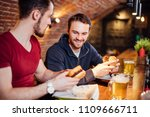 have a bite. two cheeerful men... | Shutterstock . vector #1109666711
