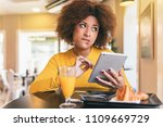 young afro woman having a... | Shutterstock . vector #1109669729