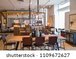 Small photo of Los Angeles, CA: June 7, 2018: Interior of a Crate & Barrel store. Crate & Barrel is wholly owned by Otto GmbH, which is based in Germany and France. Crate and Barrel opened its doors in 1962.