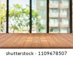 empty wood table on blurred...   Shutterstock . vector #1109678507