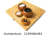 black and white stone in bowl... | Shutterstock . vector #1109686481